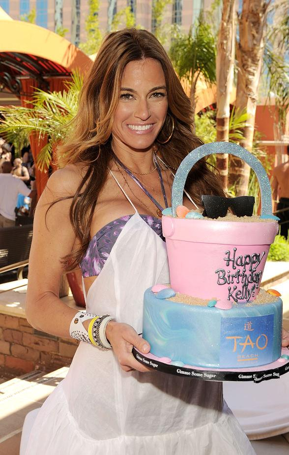 Kelly Bensimon with cake at TAO Beach