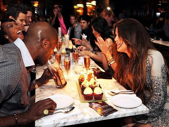 Khloé Kardashian Odom and Lamar Odom blow at the candles on her birthday cupcakes at Sugar Factory at Paris Las Vegas