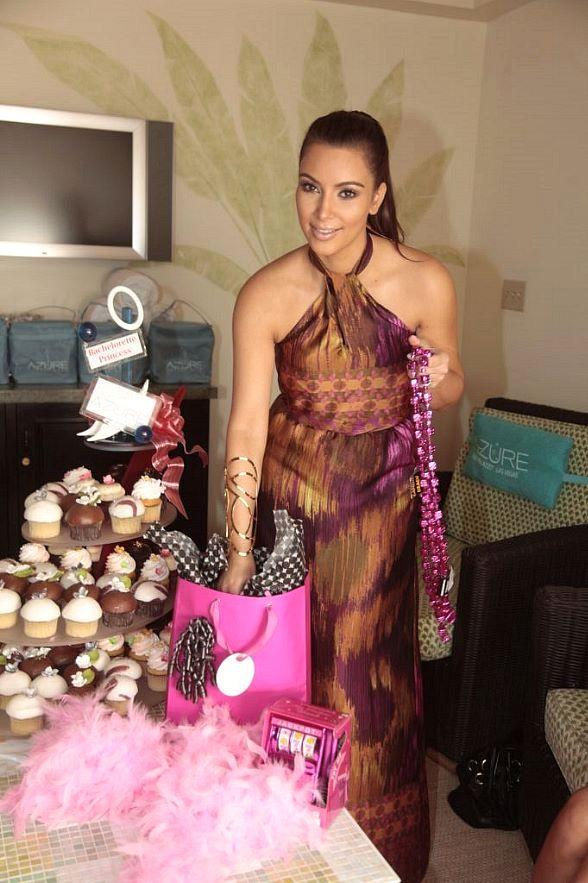 Kim Kardashian with party favors at The Pools at The Palazzo