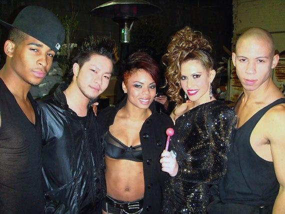 Kimberly Cole and her female back-up dancers posing with Couture Pops