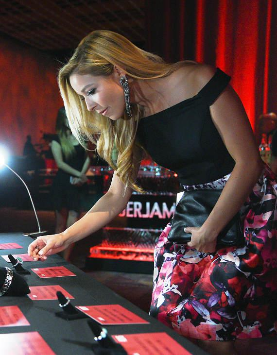 Kira Kazantsev examines auction items