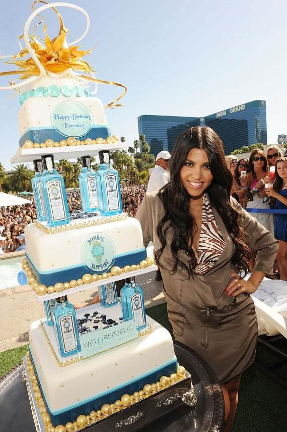 Kourtney Kardashian with Birthday Cake