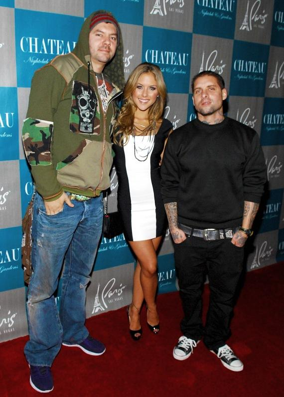 """Founders of Tapout, Tim """"SkySkrape"""" Katz and Dan """"Punkass"""" Caldwell pose with Brittney Palmer on the red carpet"""