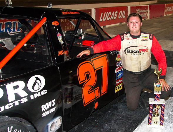 Zack Green poses in Victory Lane after winning the 50-lap Pro Truck/Southwest Tour Truck Series feature Friday night at The Bullring at Las Vegas Motor Speedway