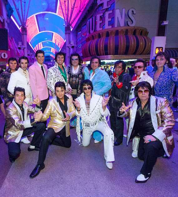 Contestants competing in the 4th Annual Las Vegas Ultimate Elvis Tribute Artist Contest at Fremont Street Experience pose underneath the Viva Vision canopy.