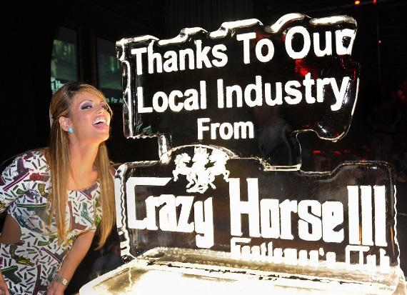 Laura Croft posing with ice sculpture at Crazy Horse III