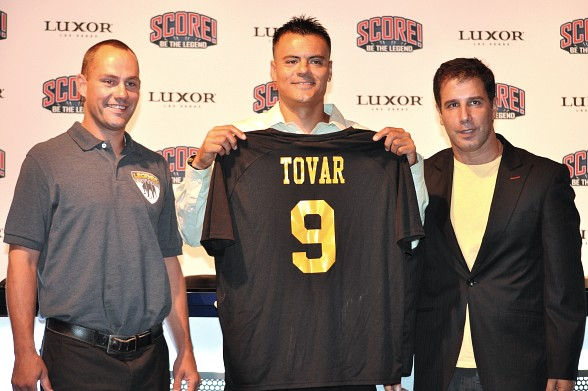 Las Vegas Legends introduce the first player in franchise history, Enrique Tovar (center), joined by Legends Head Coach, Greg Howes (left), and President and General Manager, Meir Cohen, inside of SCORE! at the Luxor Hotel & Casino