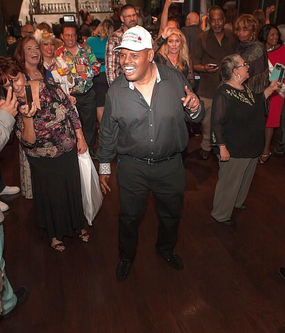 Leon Spinks greeted by his guests at Sugar Factory