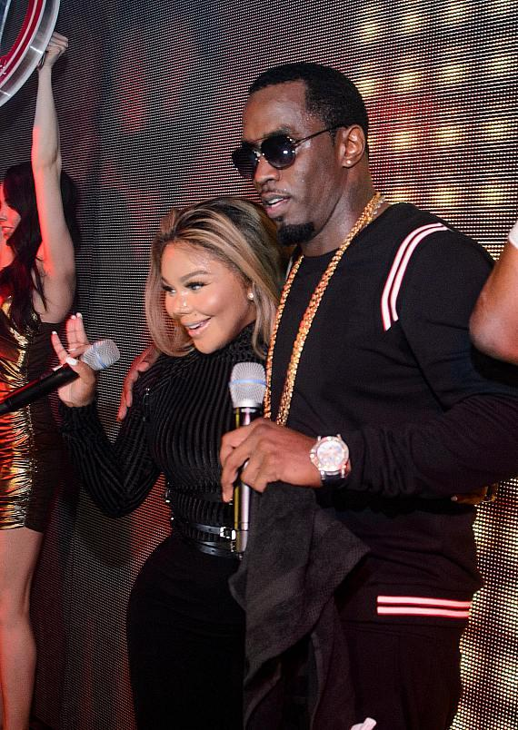 Lil Kim and Puff Daddy performing at the TAO Las Vegas 10 Year Anniversary