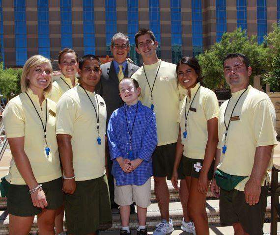 Tristin Saghin with John Caparella and lifeguards of The Venetian
