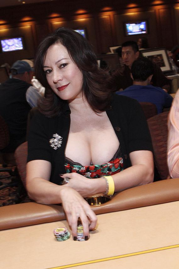 Jennifer Tilly poses at a poker table before the tournament