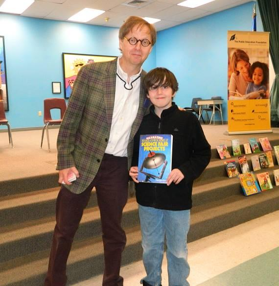"Harrah's Las Vegas Comedy-Magician Mac King poses with 5th grader Josh Tribble during an assembly to celebrate Nevada Reading Week at Edith Garehime Elementary School. Tribble helped the magician perform his ""Cloak of Invisibility"" trick during the assembly."