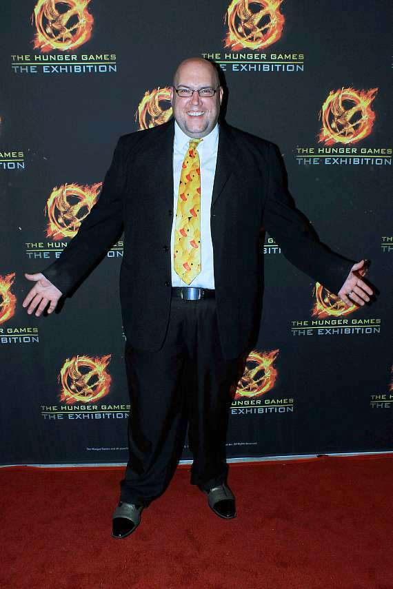 Magician Adam London at The Hunger Games: The Exhibition grand opening