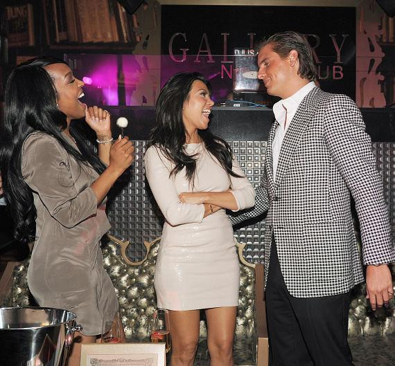 Malika Haqq, Kourtney Kardashian and Scott Disick at Gallery Nightclub at Planet Hollywood Resort & Casino in Las Vegas