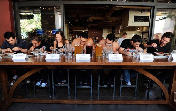 Marc Savard, Saul Ortiz, Mariah Rivera, Jon Howes, Juan DeAngelo, Mark Shunock and JC Fernandez going head-to-head during meatball eating contest at Meatball Spot