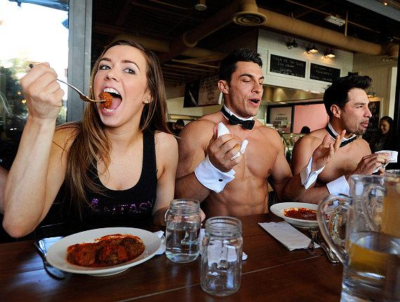Mariah Rivera, Jon Howes and Juan DeAngelo during meatball eating contest at Meatball Spot