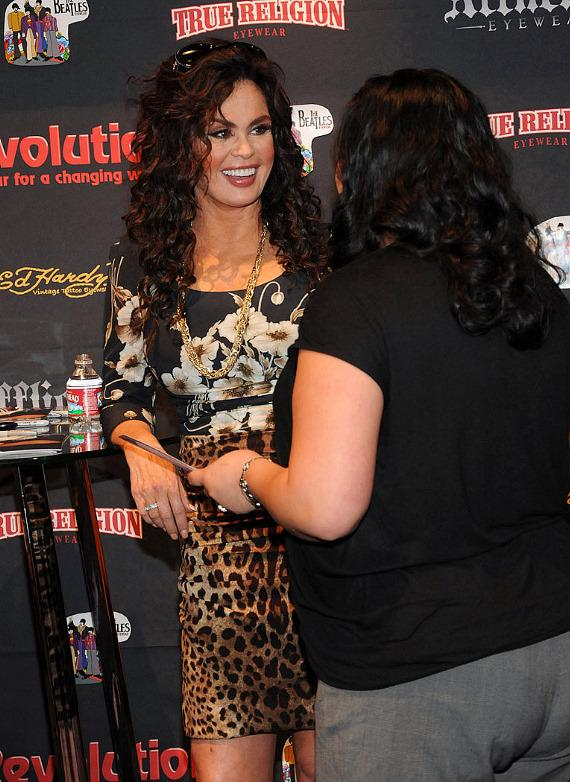 Marie Osmond with fans at the Revolution Eyewear booth at Vision Expo West