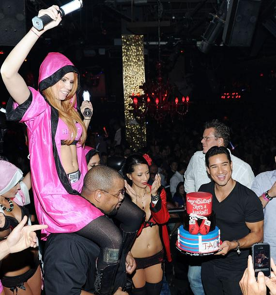 Mario Lopez with cake at bachelor party in TAO