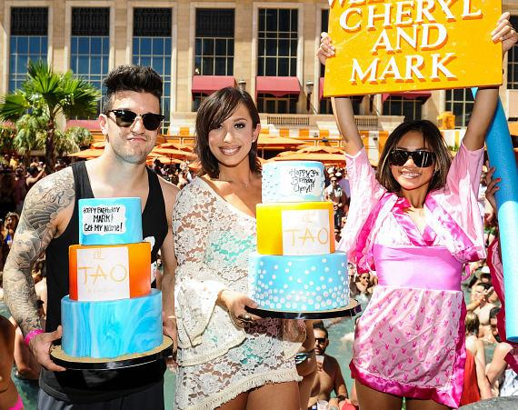 Mark Ballas and Cheryl Burke with cakes