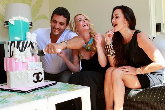Maurico cuts the cake for Kim and Kyle Richards at Azure Luxury Pool Season Opening