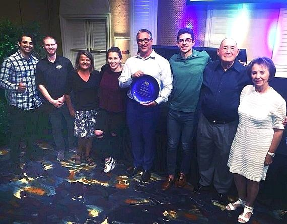 Photo: Max Pawn's Michael Mack with his family and staff after accepting an award at the PawnExpo on Tuesday, July 10 , 2018