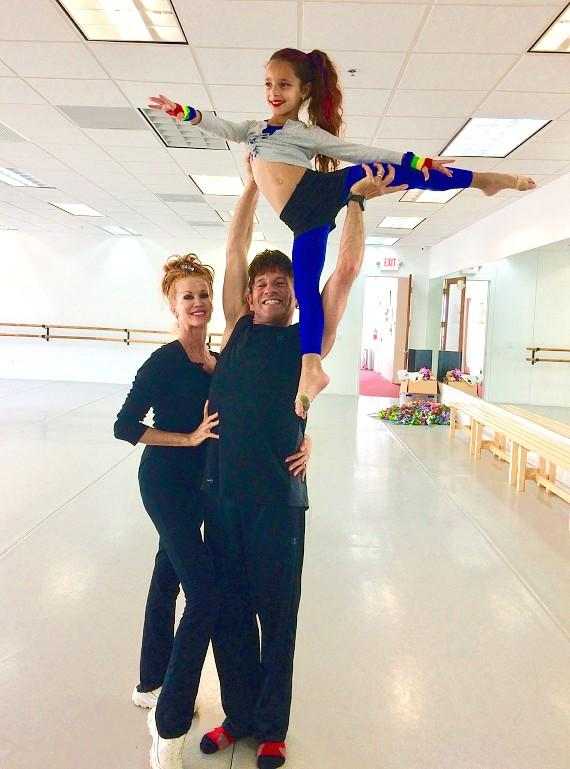 Melinda Jackson and Michael Kessler with young dancer