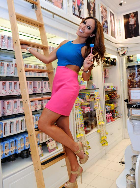Melissa Gorga with a Couture Pop inside Sugar Factory