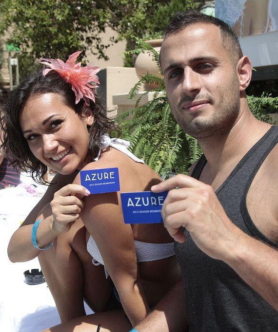 Guests show their Azure membership cards