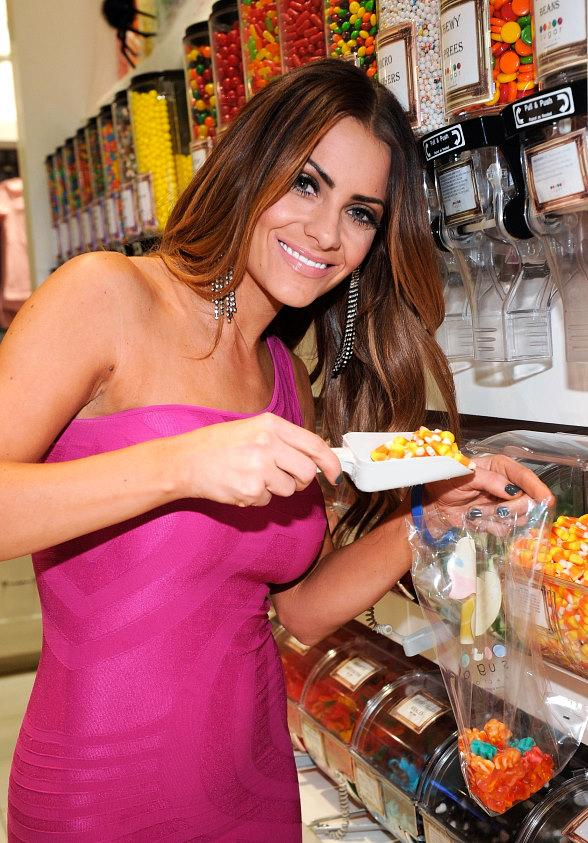 Michelle Money scoops up Halloween candy corn at Sugar Factory