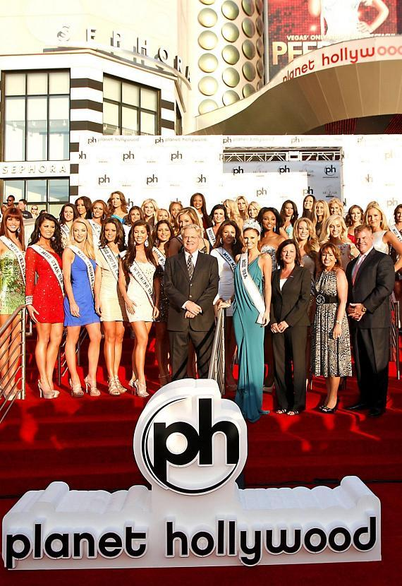 The 2012 Miss USA contestants pose with celebrity television personality Jerry Springer, reigning Miss USA Alyssa Campanella, Sr. Vice President of Marketing Las Vegas Convention and Visitors Authority, Cathy Tull, President Miss Universe Organization, Paula Shugart and David Hoenemeyer, President Planet Hollywood Resort & Casino.