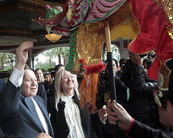 Dr. Miriam and Mr. Sheldon G. Adelson, chairman of the board for Las Vegas Sands Corp., paint the eyes of the majestic dragon