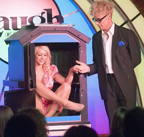 """Murray SawChuck performs """"The Puzzler"""" Illusion in 'MURRAY Celebrity Magician"""" at The Tropicana Las Vegas"""