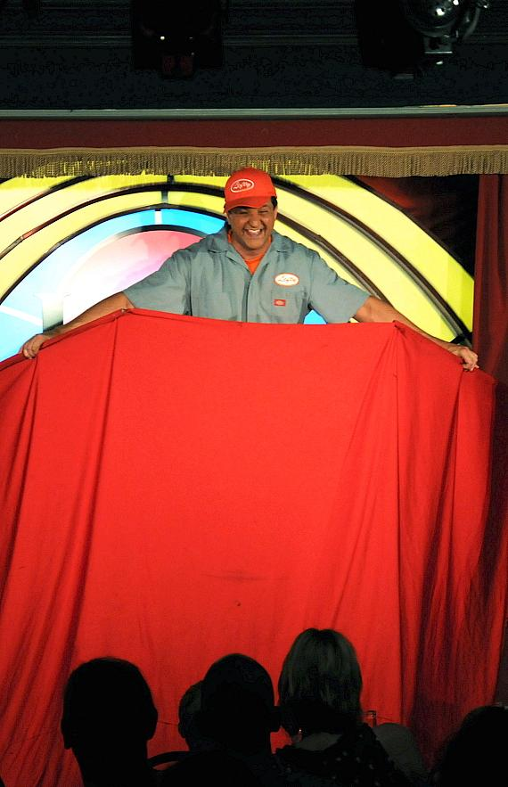 """Murray SawChuck performs the """"Surprise Crate Illusion"""" in 'MURRAY Celebrity Magician"""" at Laugh Factory in The Tropicana Las Vegas"""