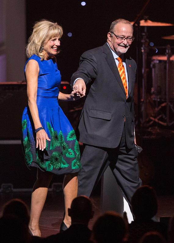 Myron Martin escorts Dr. Jill Biden offstage at second annual Heart of Education Awards, April 29, 2017