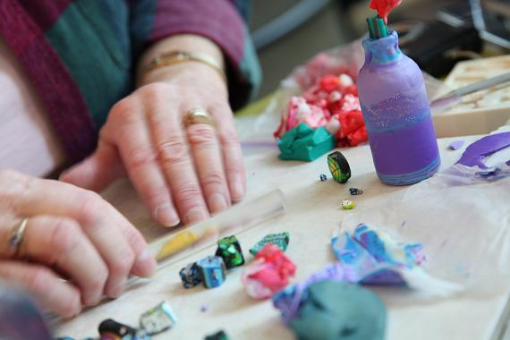 A volunteer's healing hands work to transform chemotherapy bottles into inspirational works of art this weekend during the Bottles of Hope event at Nevada Cancer Institute