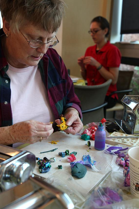 Elizabeth Norris, of Las Vegas, puts the final touches on her design at the Bottles of Hope event at Nevada Cancer Institute on Saturday