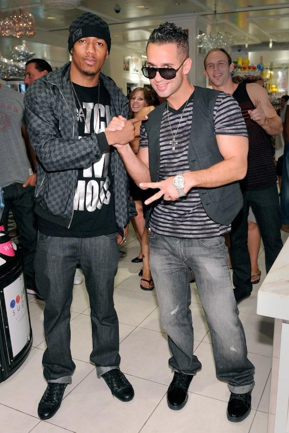 "Nick Cannon and Mike ""The Situation"" Sorrentino pose at Sugar Factory"