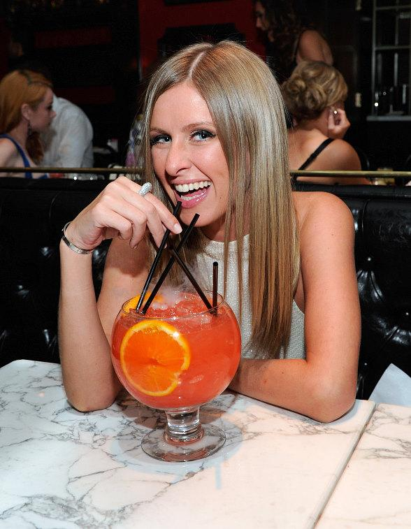 Nicky Hilton sips a Passion Punch cocktail at Sugar Factory American Brasserie