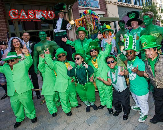 """Gathered at the entrance of O'Sheas Casino, Brian """"Lucky"""" Thomas, Joe Greene and Jennifer Michaelson, a troop of leprechauns, stilt walkers, balloon artists, green hunks and bag pipers, kicked-off O'Sheas St. Patty's Day Block Party"""