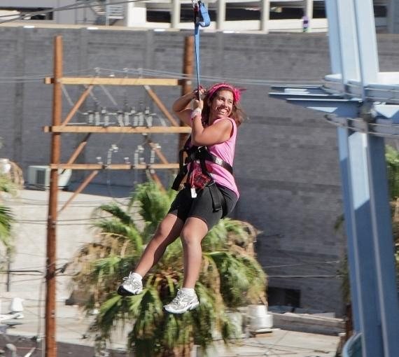 A citizen of Opportunity Village ziplines