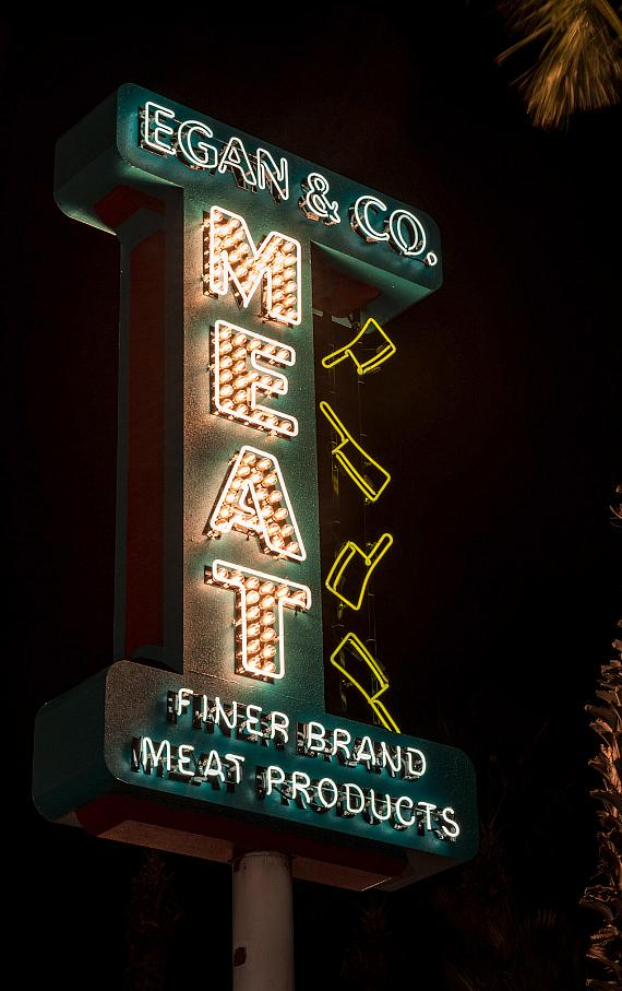 "The neon sign at the ""Official SAW Escape Experience"" in Las Vegas"