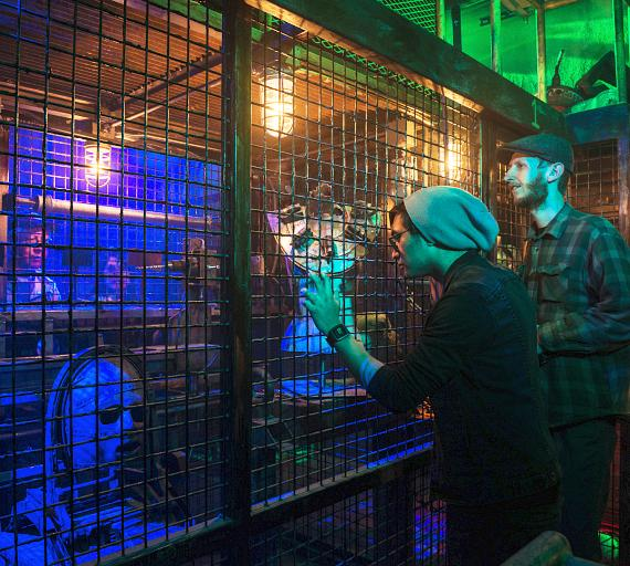 Guests look for clues at the Official SAW Escape Experience in Las Vegas