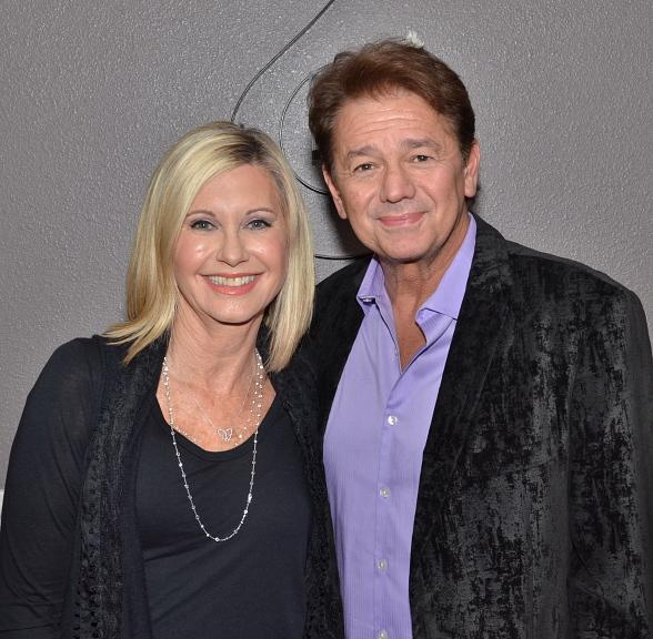 Actor Adrian Zmed with Olivia Newton-John in