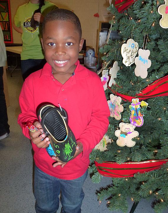 A child with his BOBS from SKECHERS shoes at the Variety Early Learning Center in Las Vegas