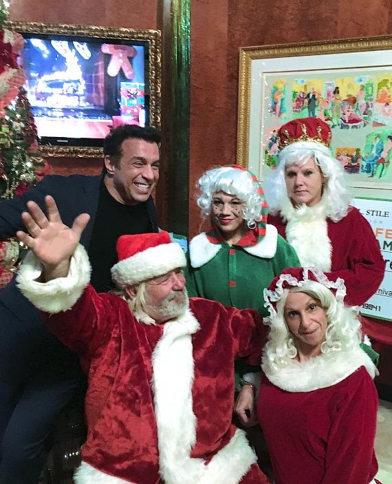 Dr. Frank Stile with Santa and Elves