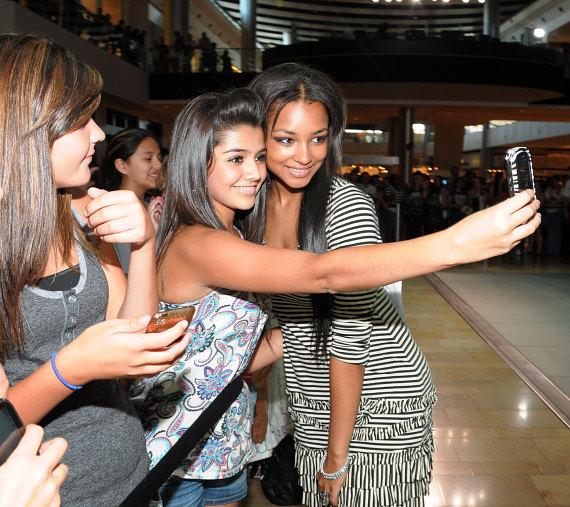 Jessica Jarrell posing with fans at Pastry Shoes fashion show in Las Vegas