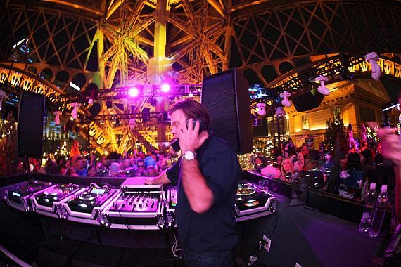 Paul Oakenfold spins at Chateau Gardens, with the Las Vegas Strip in the background