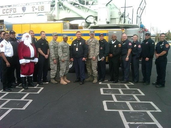 "Photo from last year's ""Fill The Fire Truck Toy Drive"""