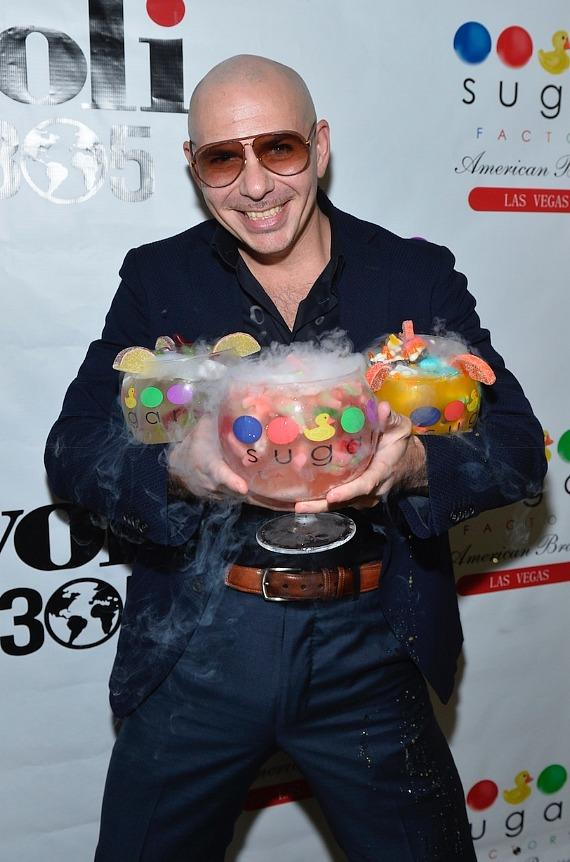 PitBull holds his 3 new signature Voli 305 Sugar Factory goblets