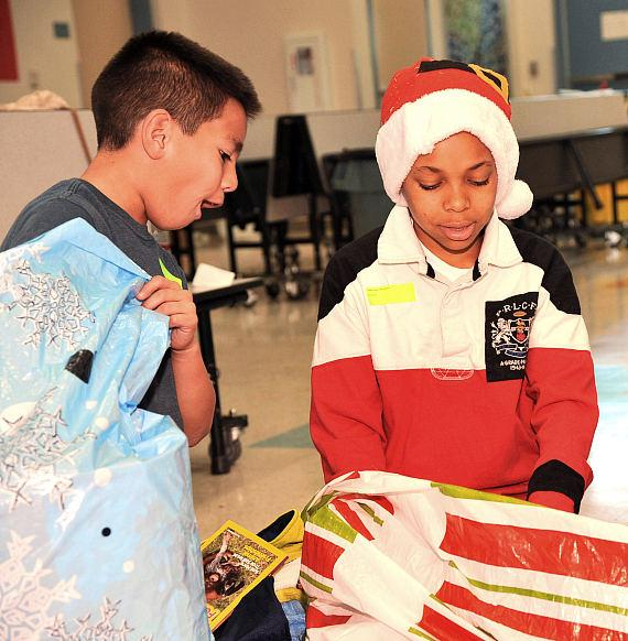 Priest Elementary students open bags